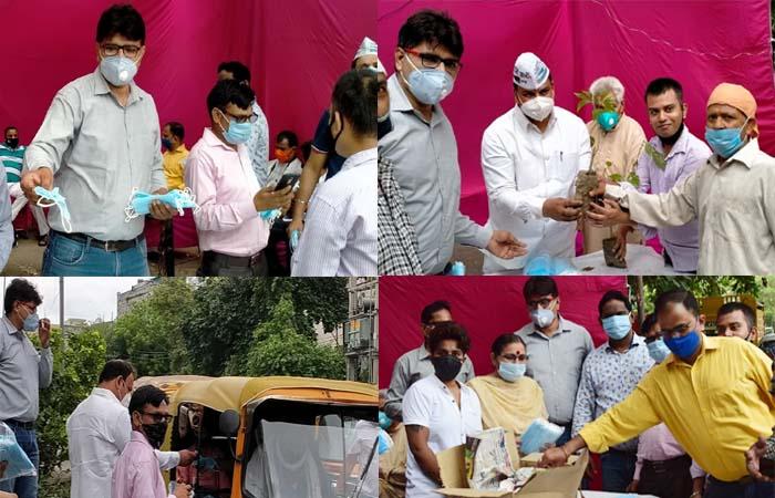विधायक दिलीप पांडेय के नेतृत्व में वार्ड नंबर 13 में किया गया मास्क एवं पौधा वितरण का आयोजन